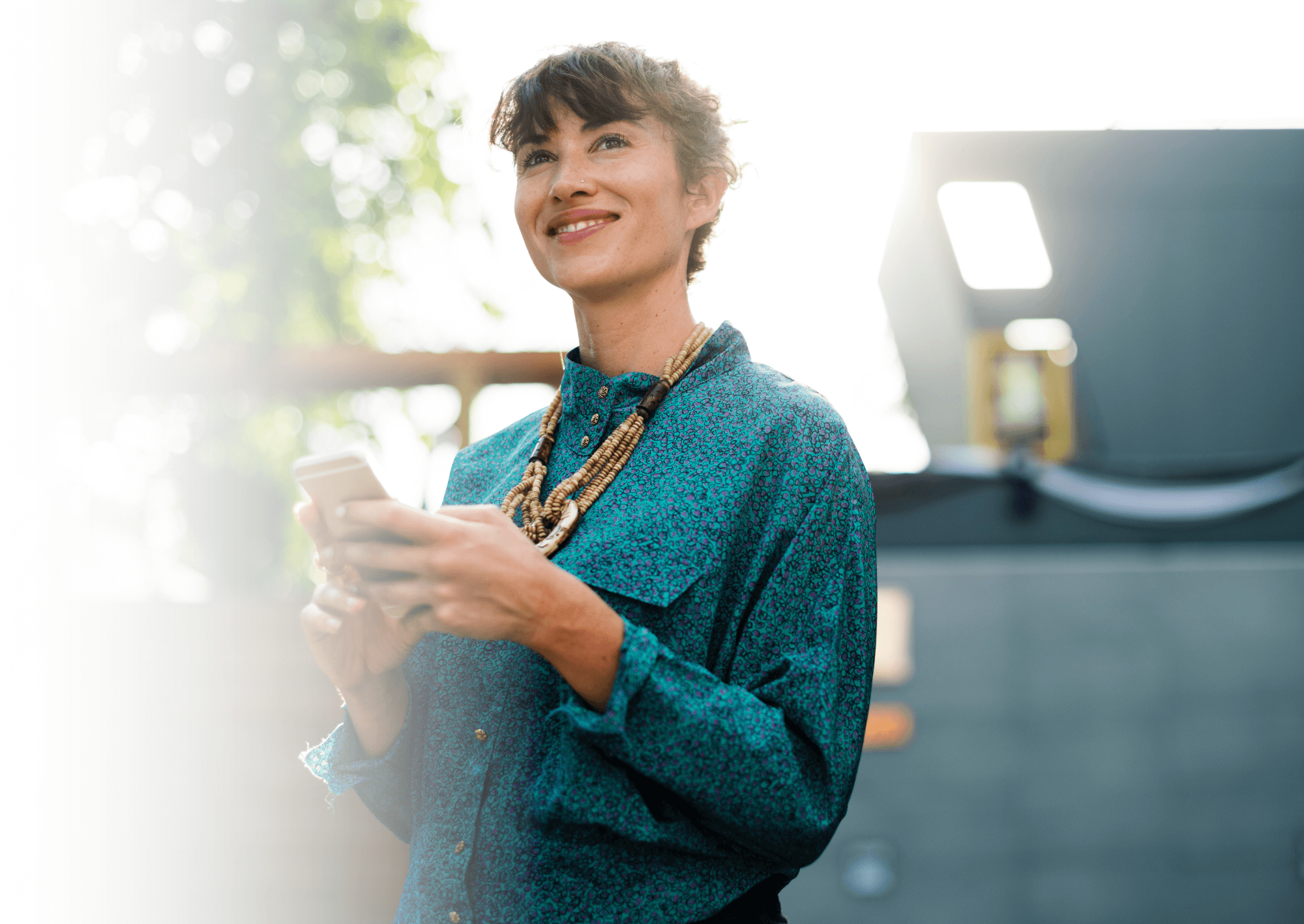 Become an Affiliate - woman holding a mobile phone