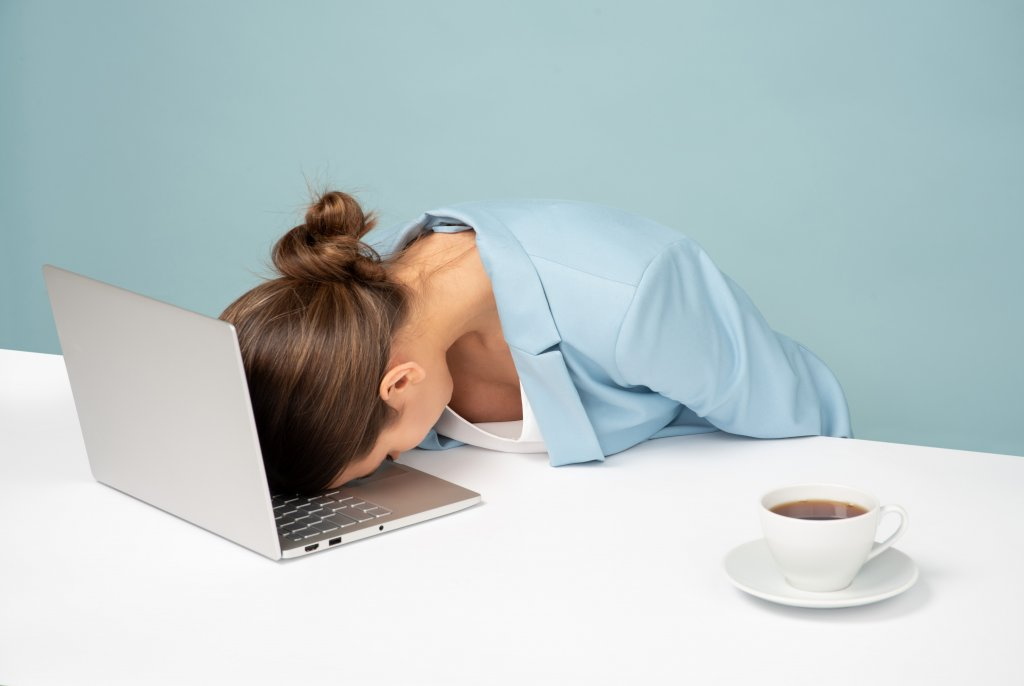 social media challenges and social media solutions struggles - woman in blue on the table