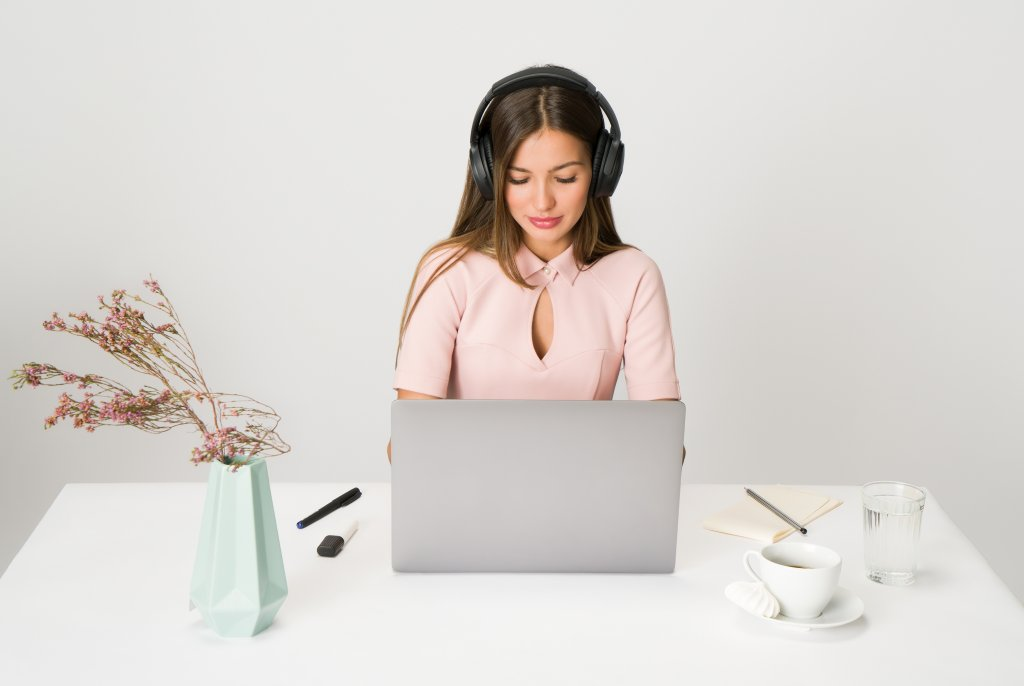 create social media posts, social media content, converting content, how to make effective social content - woman in pink with headphones in