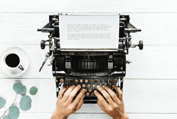 social media storytelling man writing on typewriter