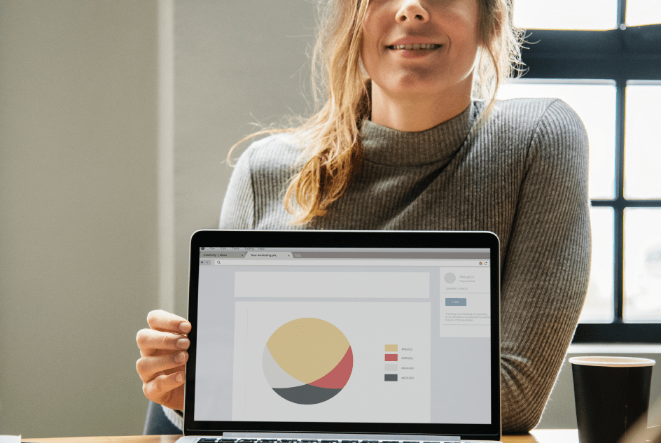 freelance digital agency woman showing analytics in-house team why use a marketing team