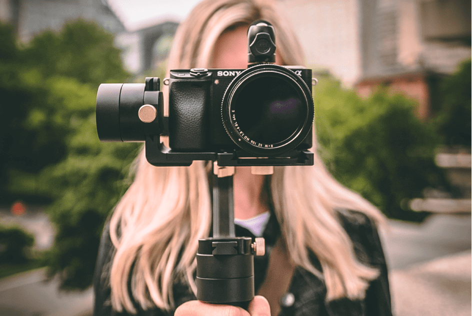 personalized video marketing woman with sony camera filming a video