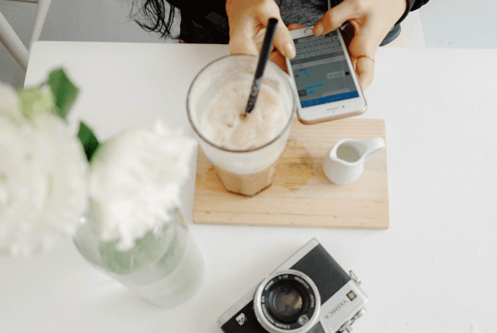 Person on phone and latte coffee Instagram Dynamic ads